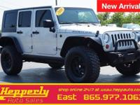 This 2010 Jeep Wrangler Unlimited Rubicon in Bright