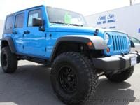 This 2010 Jeep Wrangler 4dr Unlimited Sport SUV 4D