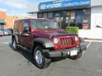 2010 Jeep Wrangler Unlimited Sport In Red Rock Crystal