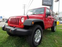 2010 Jeep Wrangler Unlimited Sport with Skyrider Top.