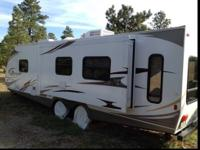 This is an awesone RV & has only 2 summers of camping.