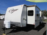 This Keystone Cougar Travel Trailer has two slide-outs