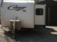 2010 Keystone Cougar 26BRS Travel Trailer. 26 feet in