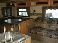 Showroom Condition. This BEAUTIFUL Travel Trailer was