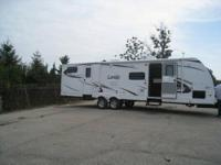 Length: 34 feet Year: 2010 Make: Keystone Model: Laredo