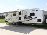 2010 Keystone Cougar XLite M26BRS Travel Trailer. This