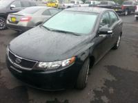 This outstanding example of a 2010 Kia Forte EX is