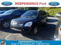 Come see this 2010 Kia Sportage LX. Its Automatic