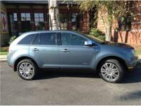 This 2010 Lincoln MKX is a Front Wheel Drive Crossover.