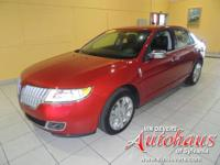 This MKZ has upgraded chrome wheels, power moonroof, 4