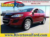 This 2010 Mazda CX-9 FWD 4dr Touring is offered to you