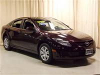 This Mazda 6 I Sport is a 2010 model. It is black
