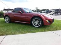 2010 Mazda Miata MX5 with tough leading convertible.