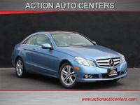 This ONE owner Quartz Blue Metallic E350 Coupe is a