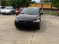 THIS 2010 MITSUBISHI LANCER IS A ONE OWNER NEW CAR