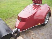 2010 Custom tow behind motorcycle trailer. Red in