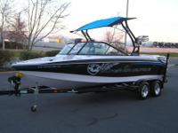 This auction is for a 2010 Nautique 210