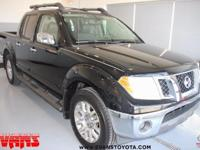 Clean CARFAX. BLACK 2010 Nissan Frontier LE 4WD 5-Speed