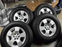 "Set of 4 - 16"" rims and tires off a 2010 Nissan"