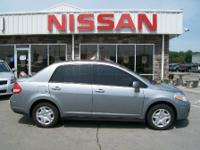 This 2010 Versa sedan was bought and serviced here from