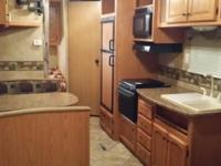 2010 North Country travel trailer, 27 ft long ,is like