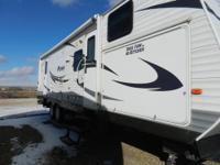 2010 30ft Puma Camper. Sleeps 8.Queen size bed in