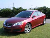 This outstanding example of a 2010 Pontiac G6 w/1SA is