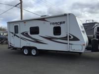 This 2010 Tracer comes with a walk around queen bed.