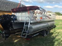 One owner 2010 party barge 21', 60 horse motor bigfoot,