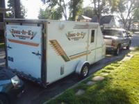 14 foot Combo camper/motorcycle hauler. Kitchen area up