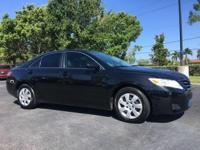 CARFAX One-Owner. Black 2010 Toyota Camry FWD 6-Speed