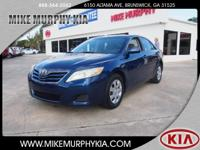 This 2010 Toyota Camry SE is complete with top-features