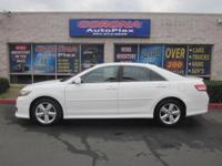 This is a gorgeous WHITE 2010 TOYOTA CAMRY SE 4 DOOR
