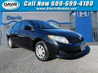 CARFAX One-Owner. Black 2010 Toyota Corolla LE FWD