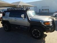 We are excited to offer this 2010 Toyota FJ Cruiser.