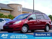 2010 Toyota Sienna in Red. Sturdy as she goes. Rare. In