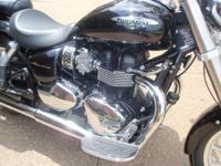 Black 2010 Triumph America, 7000 miles. Triumph brand