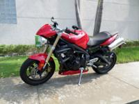 This is a beautiful 2010 Triumph Street Triple. This