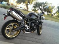 2010 Triumph Street Triple R, low miles. Well