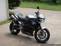 2010 Triumph Street Triple R There are only 3800 miles