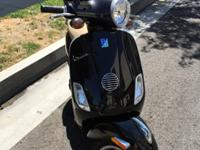 2010 black Vespa LX 150 with topcase for extra storage