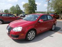 Red and Ready! Turbo! This great 2010 Volkswagen Jetta