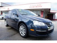 This 2010 Volkswagen Jetta 4dr SE . It is equipped with