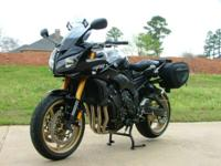 This is a 2010 Yamaha FZ1. It is a beautiful black with