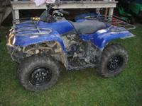 This is a 2010 Yamaha raptor 250 in like new