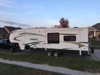 This is a 2010 Keystone Outback Sidney 321FRL Edition