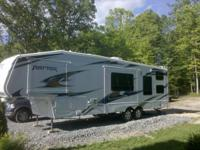 2010 Keystone raptor 300mp Toy Hauler. 35' Fifth Wheel