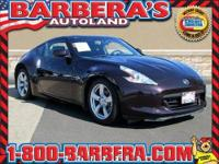 This 2010 Nissan 370Z Touring includes the 6-Speed