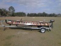 2011 16' Gheenoe with 5 HP Gamefisher 2 stroke motor. 2