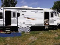 2011 26 ft Trail Runner Travel Trailer with a super